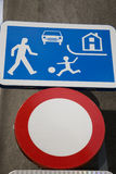 Road Safety Sign. Blue road safety sign in urban setting Stock Photos