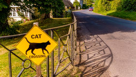 Road Safety Sign Cat Crossing. This lovely road safety sign, warning motorists that there are cat's crossing, was spotted outside of a countryside home Stock Photos
