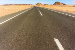 Road through Sahara desert in Egypt. Desert landscape and the road to Wadi Halfa in Egypt just before border with Sudan Stock Images
