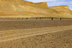 Road in Sahara desert. The landscape in the Sahara desert Morocco Royalty Free Stock Image