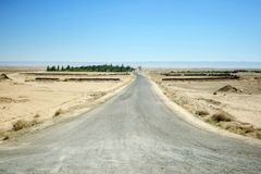 Road in Sahara desert. A road passing through the desert in middle Tunisia Stock Images