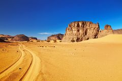 Road in Sahara Desert, Tadrart, Algeria. Desert landscape with rocks and blue sky, Tadrart, Algeria Royalty Free Stock Image