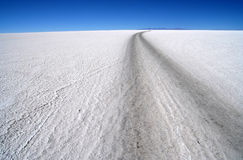 Road Through Salar. Remote road through Salar de Uyuni in Bolivia royalty free stock images