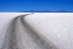 Road Through Salar. Remote road through Salar de Uyuni in Bolivia stock photography