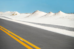 Road by Sand Dunes Stock Photos