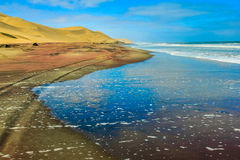 Road of sand submerged by the tide of the Atlantic Ocean Royalty Free Stock Photos