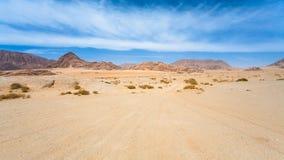 Road in sand of Wadi Rum desert Royalty Free Stock Photo