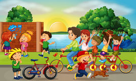 Road scene with kids and family riding bikes Royalty Free Stock Photo