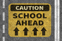 Road with School ahead caution sign Stock Photo