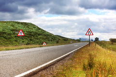 Road in Scotland, summertime. Road with road signs in Scotland, summertime Stock Photo