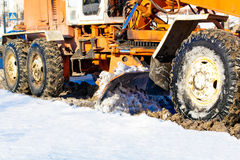 Road scraper removing snow from the roads Royalty Free Stock Image