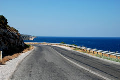 Road and sea. Road is between sea and mountain Royalty Free Stock Images