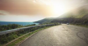Road by sea on sunny day Royalty Free Stock Images