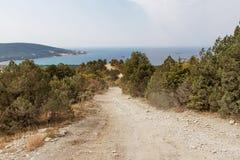 Road on the sea coast. Mountain and road on the sea coast stock photos