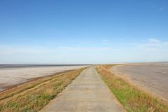 The road by the sea goes beyond the horizon.  stock photos