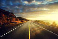 Road by the sea in sunrise time,  Lofoten island, Norway Royalty Free Stock Photos