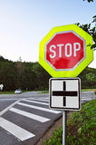 Road security, stop traffic sign. Road security or safety, stop traffic sign on a crossroad Royalty Free Stock Image