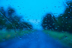 Road seen through water drops Royalty Free Stock Images