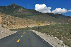 Road with a sharp curve. Landscape of the road with a sharp curve in the highlands of Tibet stock photography
