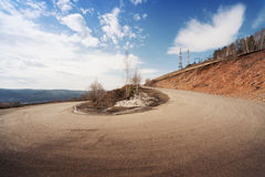 Road sharp curve. Road on a hill with abrupt turns stock photos