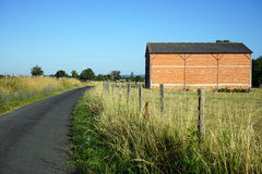 Road and shed Stock Images