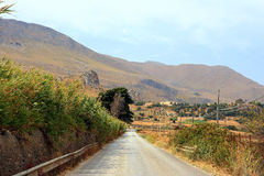 Road in Sicilian countryside. Road in dry Sicilian countryside at end of summer Stock Photography