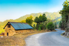Road-side hill house Royalty Free Stock Photography