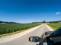 Road and side mirror good sunny weather royalty free stock image