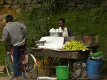 Kodaikanal, Tamil Nadu, India - June 11, 2010 A road side vendor selling tea and snacks. A road side vendor, tea stall selling tea and snacks near Kodaikanal Stock Photos