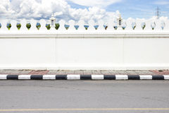Road side and white big wall and Thailand country view in backgr Royalty Free Stock Photos