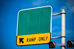 Road sign. Blank highway or road sign showing ramp only indication royalty free stock photography