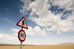 Road sign. Against cloudy background Royalty Free Stock Image