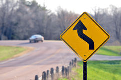 Road Sign. A standard road sign in sharp focus with the background thrown out of focus Royalty Free Stock Photography