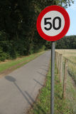 Road sign. Urging drivers to drive maximum 50 km/h Stock Image