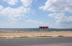 Road sign. Near the lake coast Stock Photography