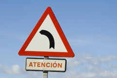 Road sign. For a bend in the road in Spanish stock photography