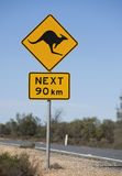 Road sign. Kangaroos next 90km,in outback, Australia Stock Photography