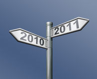 Road sign 2010 2011 new year. Road sign two arrows indicating to past and future 2010 and 2011 old to new year Stock Photos