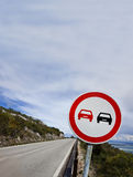 Road sign. Prohibited overtaking sign in a mountain road Royalty Free Stock Photography