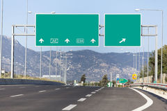 Road sign. Blank highway road sign with two directions Royalty Free Stock Image