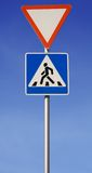 Road sign. Pedestrian across road. File contained clipping path Stock Images
