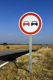 Road sign. A no surpass road sign against a clear sky stock photography