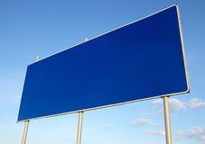 Road sign. Blank blue billboard and sky Royalty Free Stock Photos