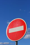 Road-sign. Prohibiting road-sign at the blue sky with little fluffy clouds. with clipping path Stock Photos