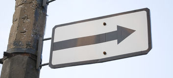 Road sign. White road sign with arrow royalty free stock images