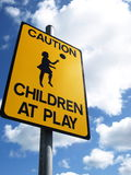 Road sign. Yellow preventive sign about children at play Royalty Free Stock Photography