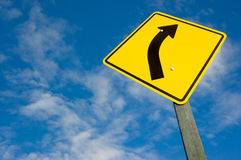Road sign against a blue sky Royalty Free Stock Image