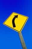 Road sign against a blue sky clipping path. Stock Images