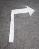 Road sign arrow at asphalt texture surface Royalty Free Stock Photo