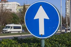 Road sign. Arrow in circle for trafic control stock photos